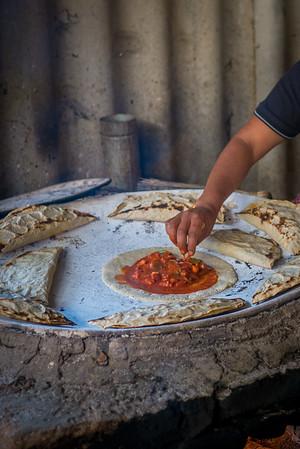 traditional empanada with mole amarillo and chicken