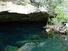 A large Cenote opening of Chac Mool in which most of the beauty lies beyond the darkness you see here. It is much bigger and has much more depth and dimension than imagined when looking at these photos.