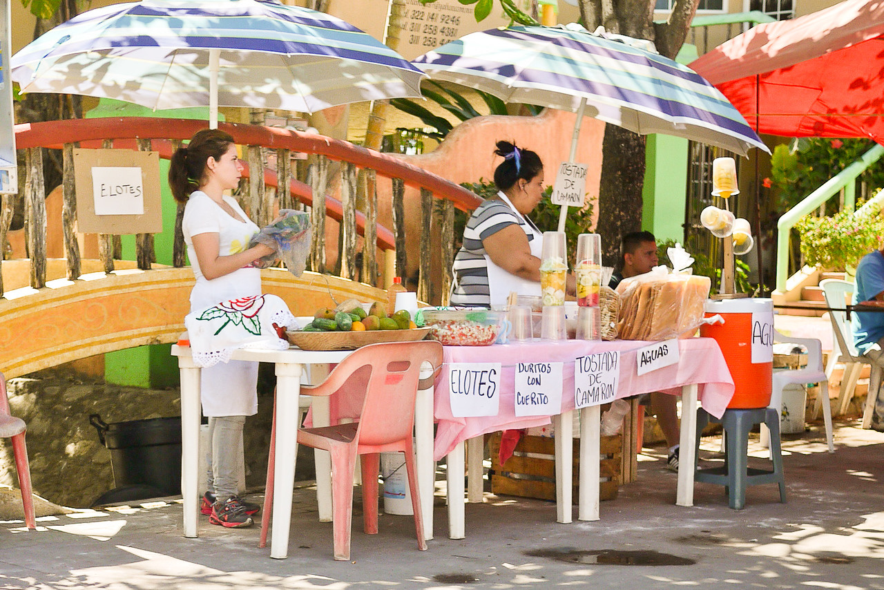 A pop-up street-food stand selling ceviche, eliotes, and agua frescos.
