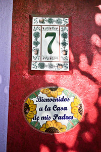 "A welcome sign on a house in town says ""Welcome to my parent's house"" in San Pancho, Mexico."