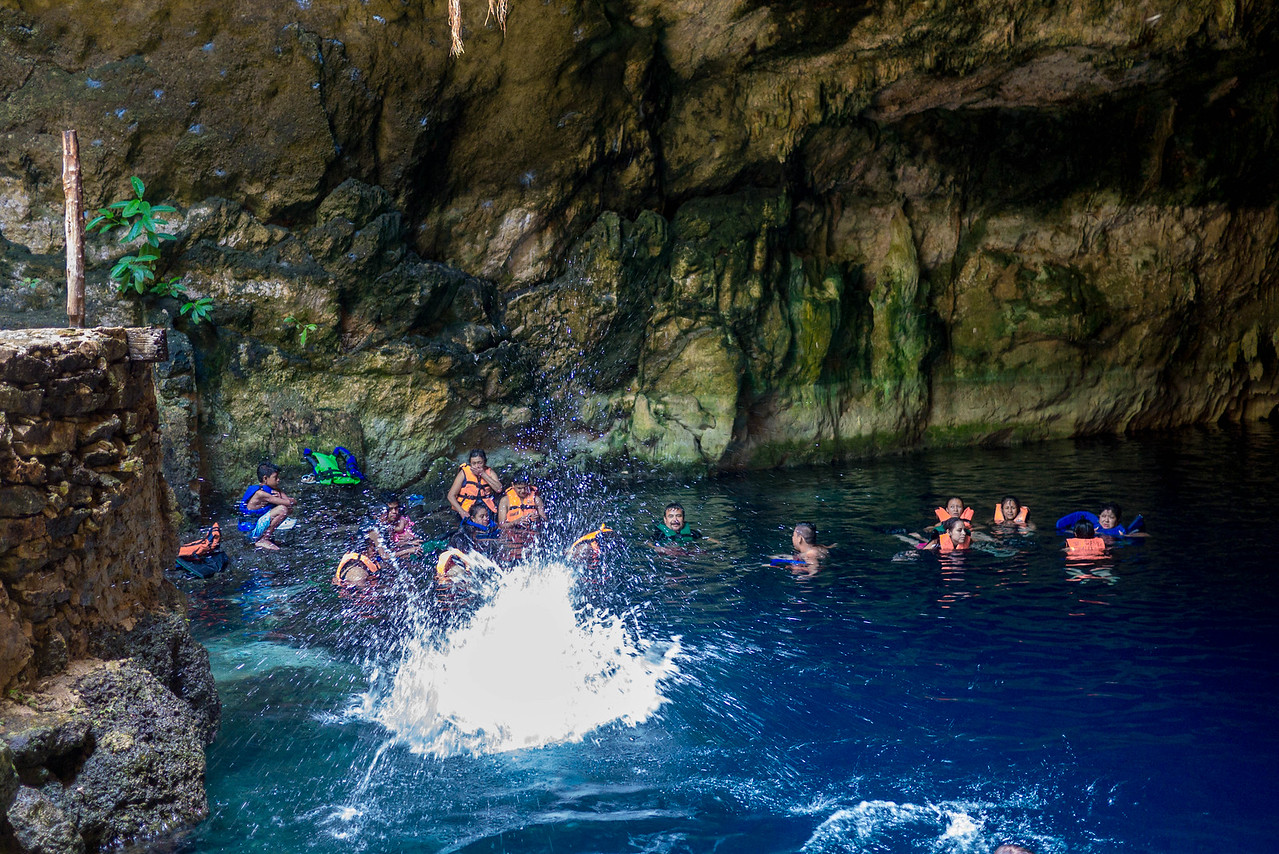 Vic jumping into the cenote