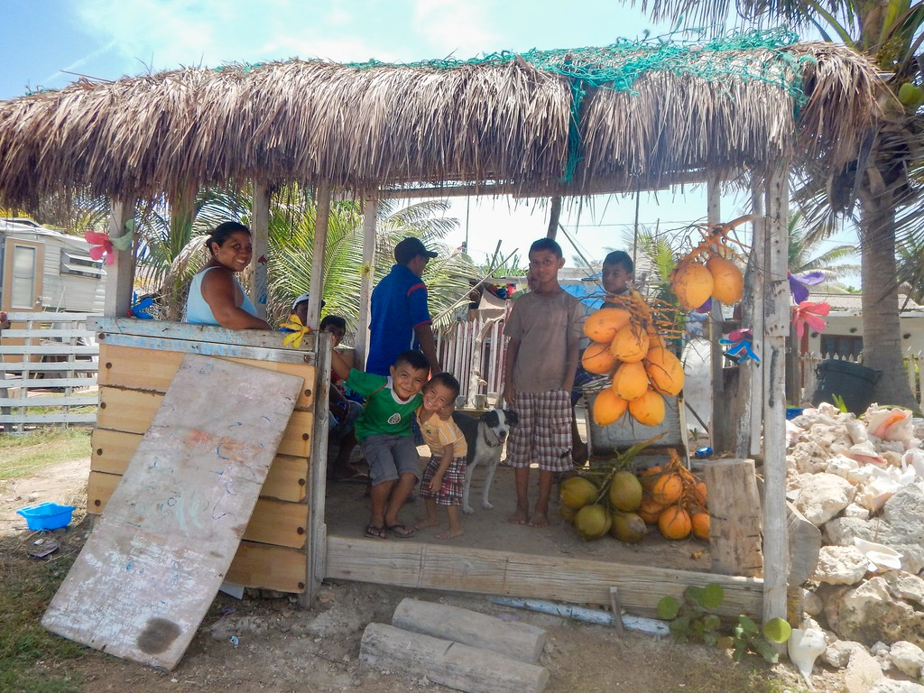 Kids selling coconuts on Isla Mujeres