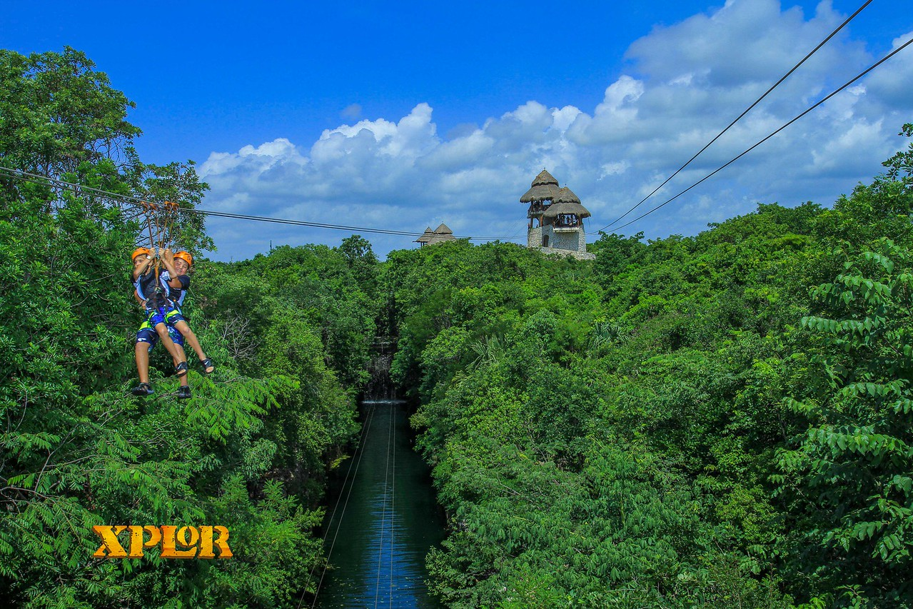 The boys together zipping over the jungle!