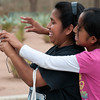 Mother and daughter take photos with a digital camera, Oaxaca, Mexico.