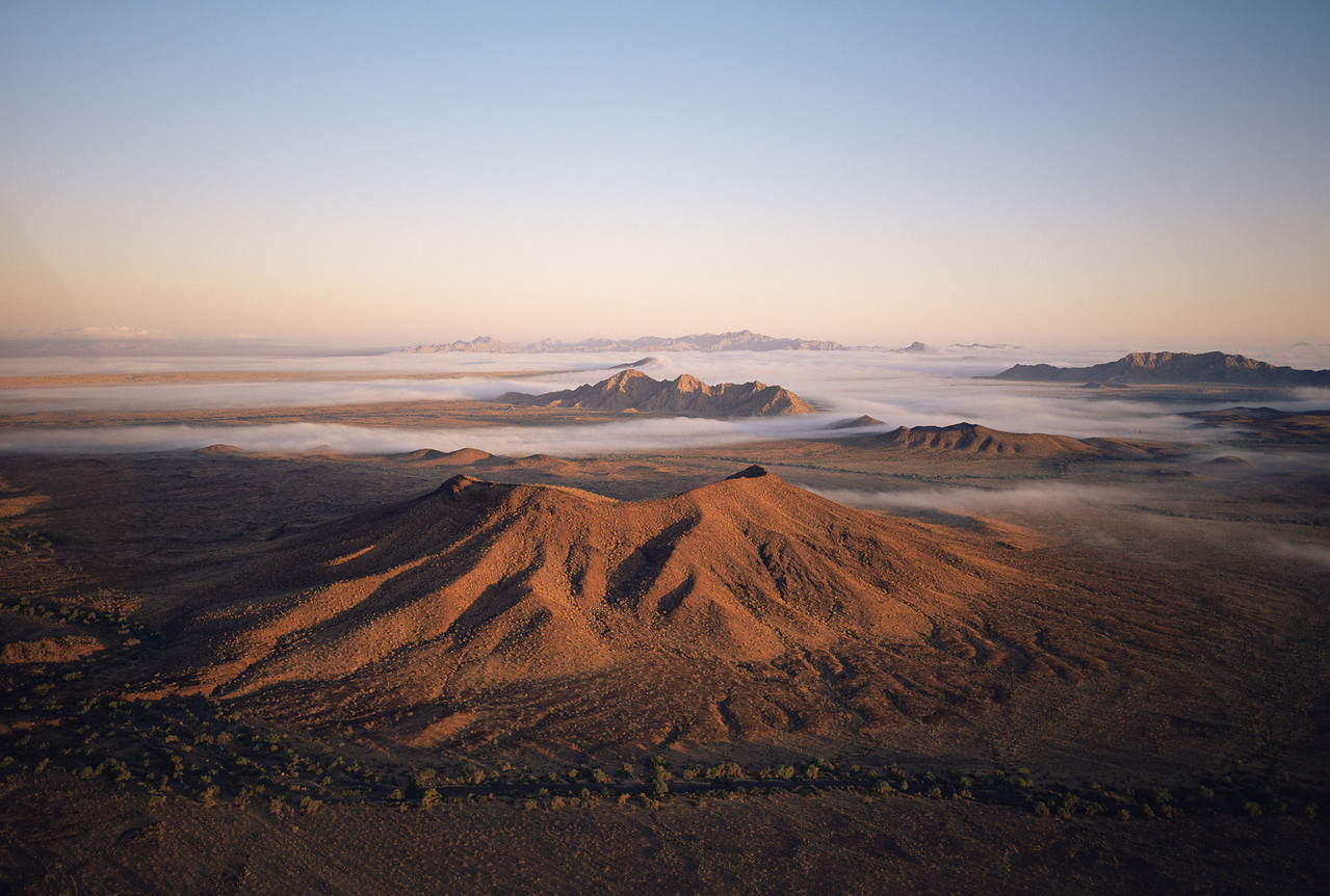 Biosphere Reserve of the, MEX/Pinacate & Gran Desierto Altar, Sonora Mexico. Sierra Hornaday, distant right and several un-named volcanos rise through morning fog.1193h6X91