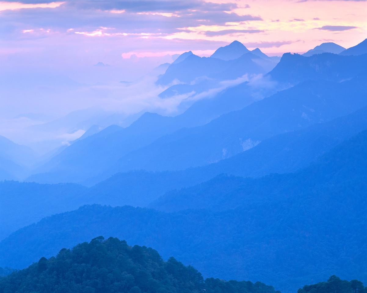 Nuevo Leon, Mexico / Cumbres National Park, / Sierra Cumbres ridge lines in fog shrouded sunrise light. 1203H3