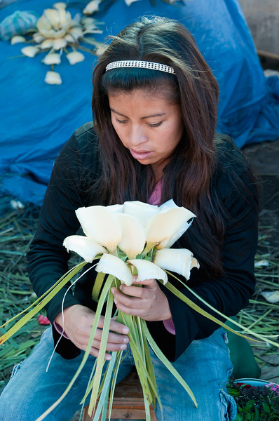 Young woman makes a decoration of maguey petals for Semana Santa, Oaxaca, Mexico.