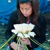 Young woman makes a decoration of maguey petals for Semana Santa, Oaxaca, Mexico.