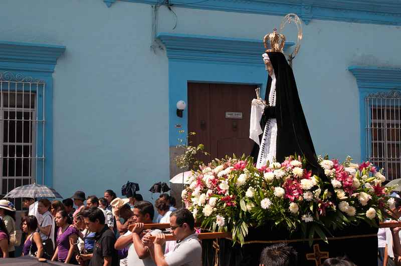 Oaxaca's patron saint, the Virgen de la Soledad, is carried through the streets during a Semana Santa procession, Oaxaca, Mexico.