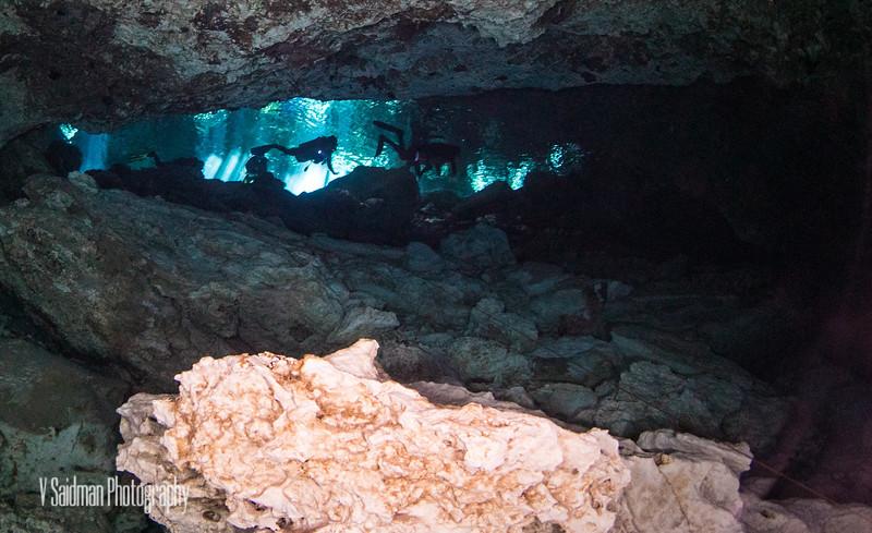 Scuba divers entering the cenote.