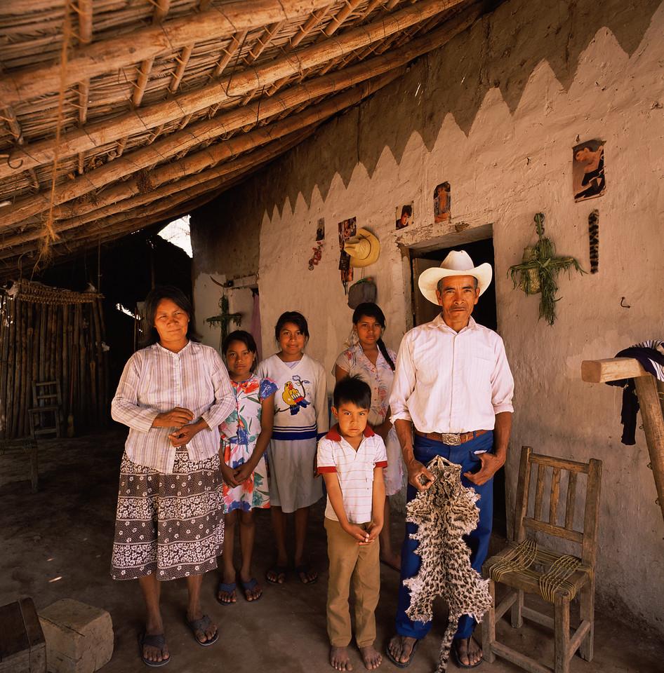 Sierra Madre foothills., MEX/Rancho San Pedro. Family living near the Rio Cuchujaqui with Ocelot (Felis pardalis) pelt. 5926x65
