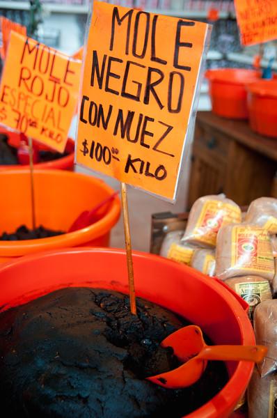 Mole paste for sale in Mercado Juárez, Oaxaca, Mexico.