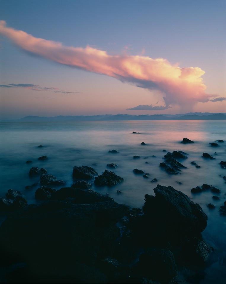 Baja Sur, Punta Chivato,, MEX/Bahia de Santa Ines, Sea of Cortez, volcanic rock amid surf with classic thunder storm across the bay. 1088v                          a
