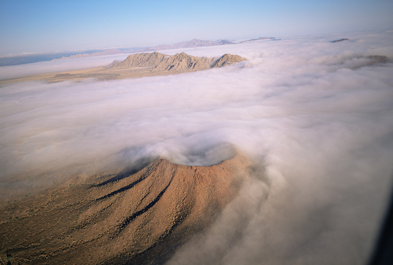 Biosphere Reserve of the, MEX/Pinacate & Gran Desierto Altar, Sonora Mexico. Crater Caravajales with ground fog swirling. 1193h6x99