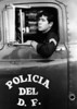 Mexico City Policeman posing for his picture in a paddy wagon (ca 1969)