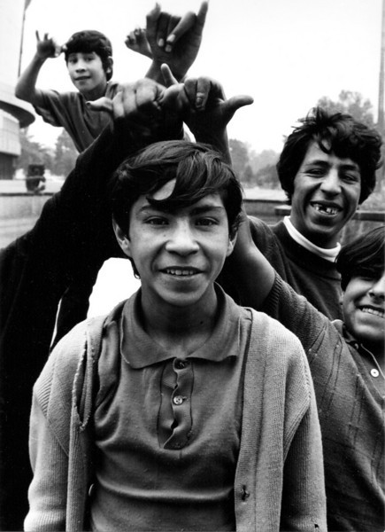 """A kid poses unaware that he's getting """"horns"""", Mexico City (ca. 1969)"""