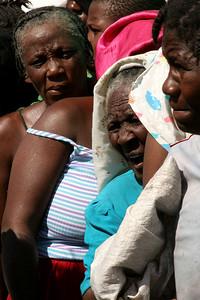 Cité Soleil, Haiti (Panetta)  Women wait under the scorching sun to receive fresh water and rice.