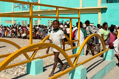 Cité Soleil, Haiti (Panetta)  People wait in line for hours to receive potable water and rice.