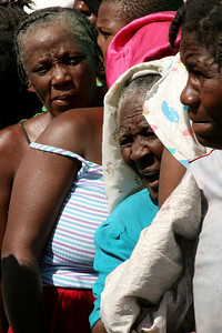 Cité Soleil, Haiti (Panetta)  Women wait in line to receive potable water and rice.