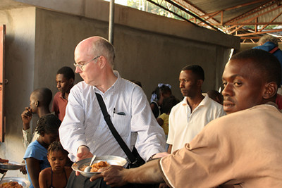 "<a href=""http://www.opticalrealities.org/GuestProfiles/Bill-Quigley-Bio"" target=""_blank"">Bill Quigley</a> reporting from Haiti (January 25 - 30, 2010). <em>The photo accompanying this article was taken at St. Clare's Parish in 2004.</em>  <span style=""color:#CC9900""><strong>""Hell and Hope""</span></strong> <em>by Bill Quigley</em>   <span style=""color:#CCCCCC"">Smoke and flames rose from the sidewalk. A white man took pictures. Slowing down, my breath left me.  The fire was a corpse.  Leg bones sticking out of the flames.  Port Au prince police headquarters is gone, already bulldozed. A nearby college is pancaked. Government buildings are destroyed. Stores fallen down.  Tens of thousands of buildings destroyed. Hundreds of thousands homeless... <br> ...After days in Port au Prince I have seen only one fight - two teens fighting on a street corner over a young woman. No riots. No machetes.  Hope is found in the people of Haiti.</span> <a href=""http://www.opticalrealities.org/Articles/Haiti/Jan2010-Hell-and-Hope/"" target=""_blank""><em>Read complete article</a></em>"