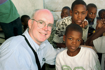 "<a href=""http://www.opticalrealities.org/GuestProfiles/Bill-Quigley-Bio"" target=""_blank"">Bill Quigley</a> reporting from Haiti (January 25 - 30, 2010). <em>The photo accompanying this article was taken at St. Clare's Parish in 2004.</em>  <span style=""color:#CC9900""><strong>""On the ground in Port au Prince""</span></strong> <em>by Bill Quigley</em>  <span style=""color:#CCCCCC"">Hundreds of thousands of people are living and sleeping on the ground in Port au Prince.  Many have no homes, their homes destroyed by the earthquake.  I am sleeping on the ground as well - surrounded by nurses, doctors and humanitarian workers who sleep on the ground every night. The buildings that are not on the ground have big cracks in them and fallen sections so no one should be sleeping inside.  There are sheet cities everywhere.  Not tent cities.  Sheet cities.  Old people and babies...  ...The scenes of destruction boggle the mind.  The scenes of homeless families, overwhelmingly little children, crush the heart.  But hope remains.  Haitians say and pray that God must have a plan...</span> <a href=""http://www.opticalrealities.org/Articles/Haiti/On-the-Ground/"" target=""_blank""><em>Read complete article</a></em>"