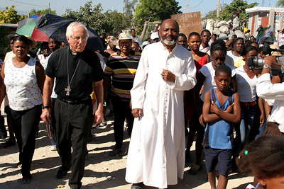 Friends and parishioners from St. Clare's church in Delmas, Port-au-Prince celebrate Fr. Jerry Jean-Juste recent release from prison.  (Panetta)