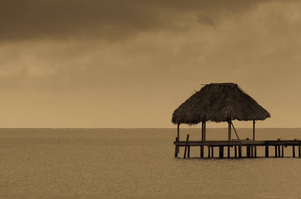 Thatched hut on a dock in Caye Caulker, Belize