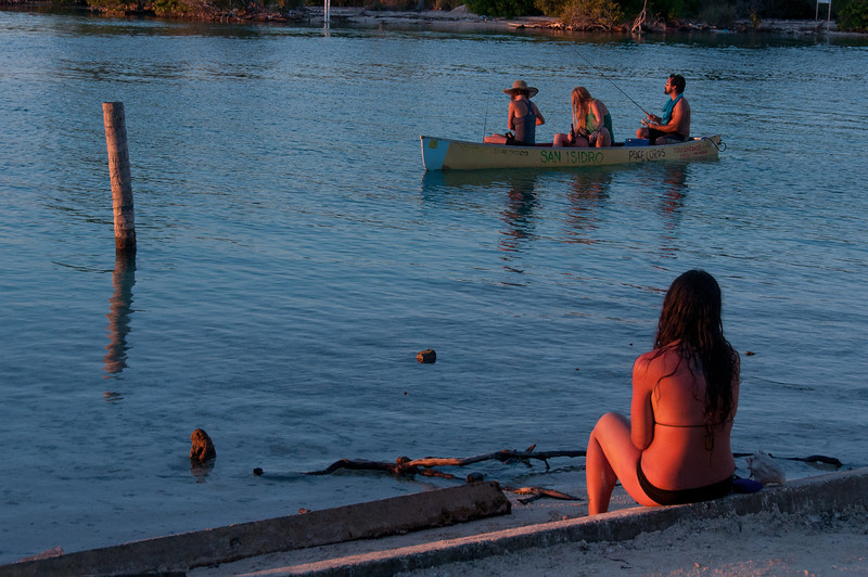 Tourists fishing in Caye Caulker, Belize