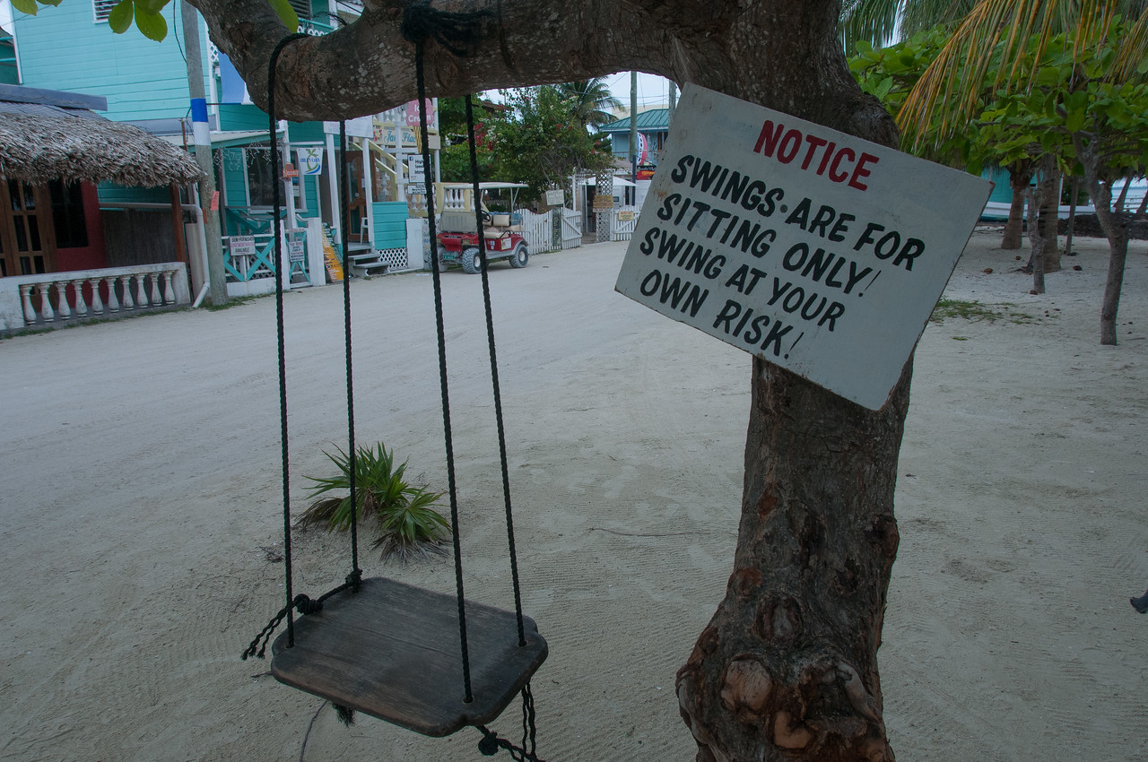 Swing with sign in Caye Caulker, Belize