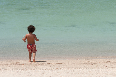 Child playing on a beach in La Paz, Mexico