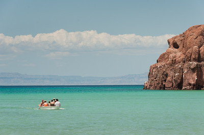 Tourists on a boat off a coast in La Paz, Mexico