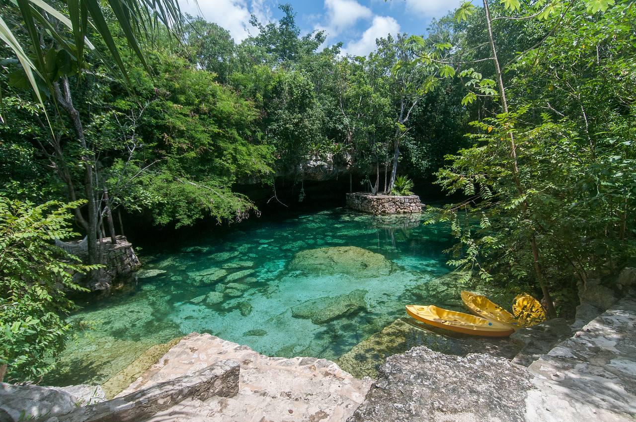 Kayaks in Crystal Clear Water in the Mayan Rivera, Mexico