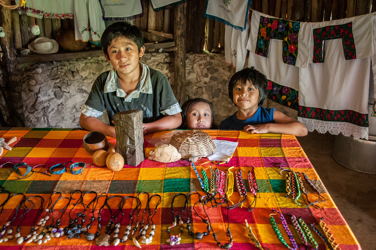 Kids selling handicrafts in Mayan Riviera, Mexico