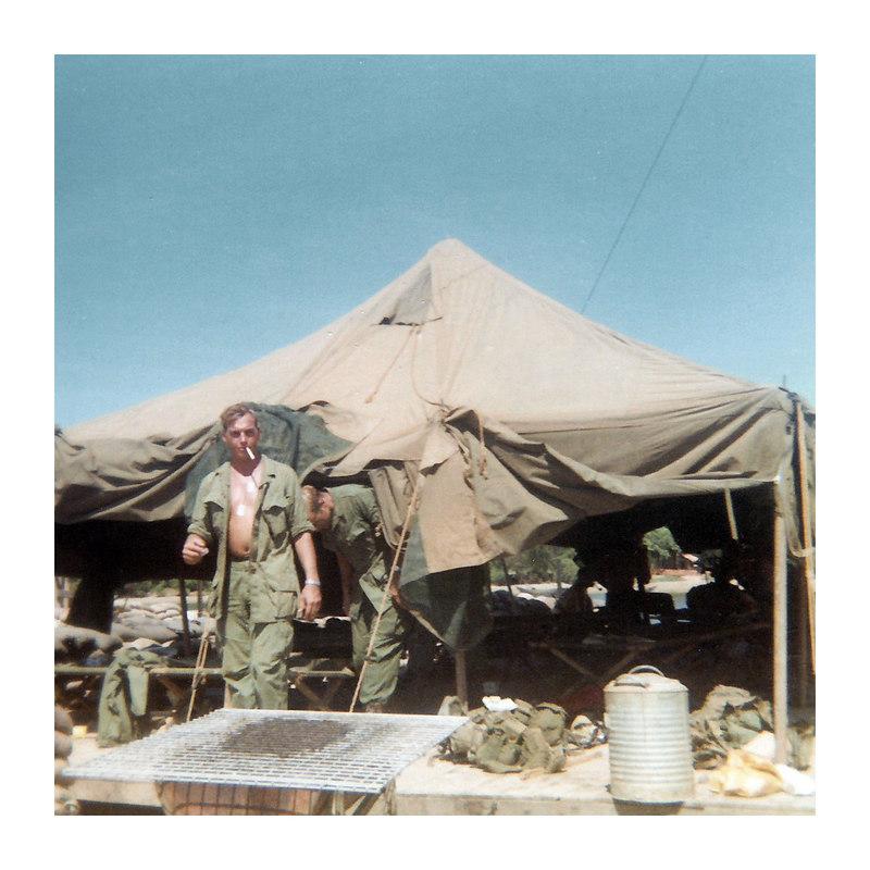 JM57:Philip Dodds (LA) and Norman Walter exit a tent at the north end of the An Tan Bridge