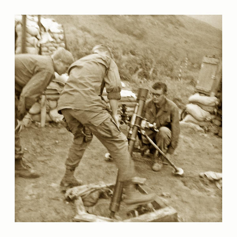 JM104: 4th Platoon grunts around the 81mm mortar #3. On left is Johnny Willard, instructing, Larry Lennon, and kneeling is Arland D. Garrett.