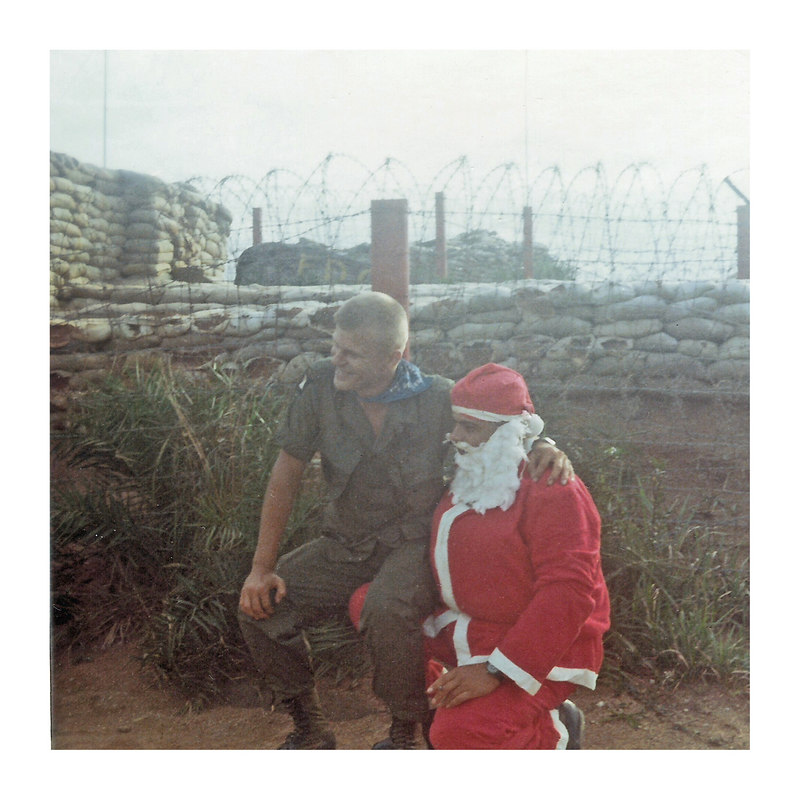 """JM83: Is this CO CPT John Plese with Santa in 1968? Note his blue neckerchief and 'Screaming Eagle' shoulder patch.  John was a platoon leader first platoon, and later executive officer of B Company, 2nd BN, 327th Inf, 101st Airborne on his first tour in 66/67. Here is a link in his honor from that unit: <a href=""""http://screamingeagles-327thvietnam.com/second/plese.htm"""">http://screamingeagles-327thvietnam.com/second/plese.htm</a>"""