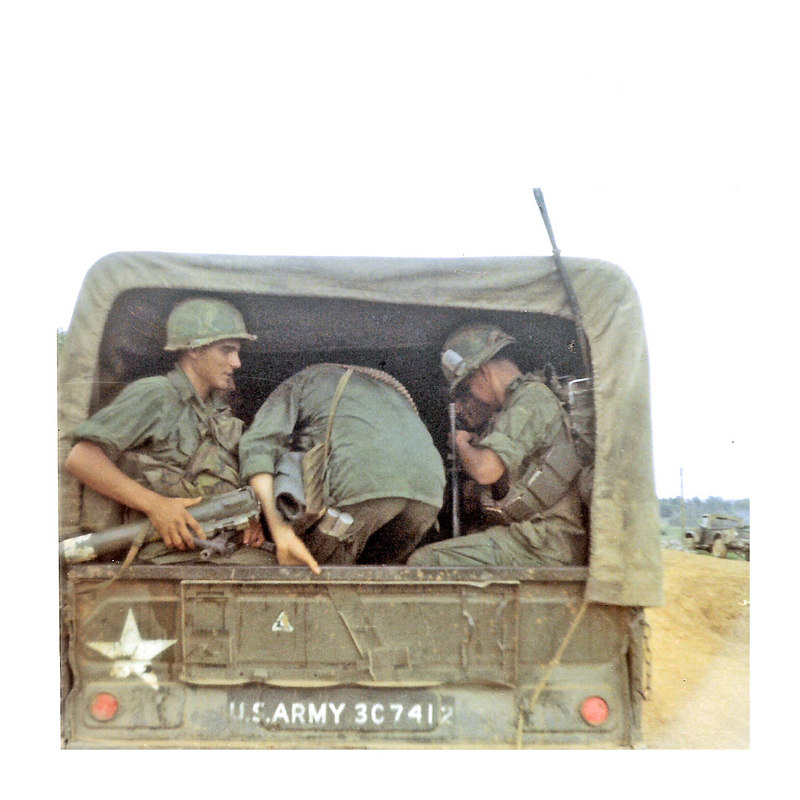 JM35: Grunts with full gear, including a LAW, packs and bandoliers of M-16 ammo, board a 3/4-ton truck