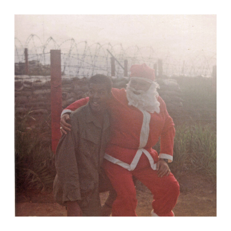 JM85: Larry 'Pretty Boy' Banker (OH) with Santa, 1968