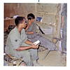 JM22: Two unidentified grunts in barracks. Who are they? Note the Gleem toothpaste, Schaefer beer, Lucky Strikes, and M-16