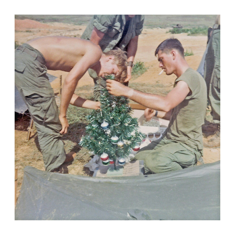 JM88:   Larry Lennon on left and on right kneeling w/cig is Bob Mears with a Christmas Tree sent from home, 1968.