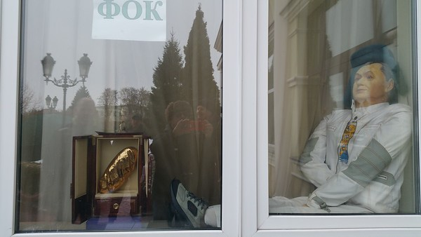 A dummy sits in the window along with a replica loaf of gold bread..this means something to the locals by all accounts.