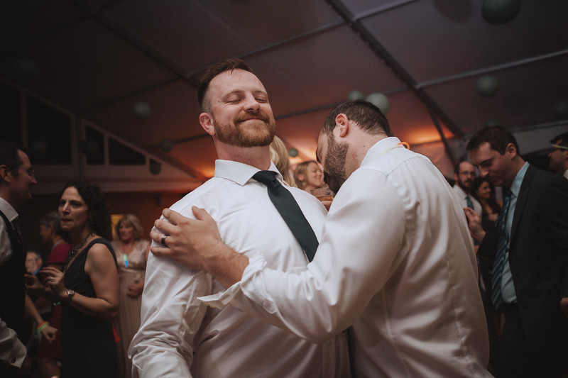 The groom and the Other Mike dancing and smiling.