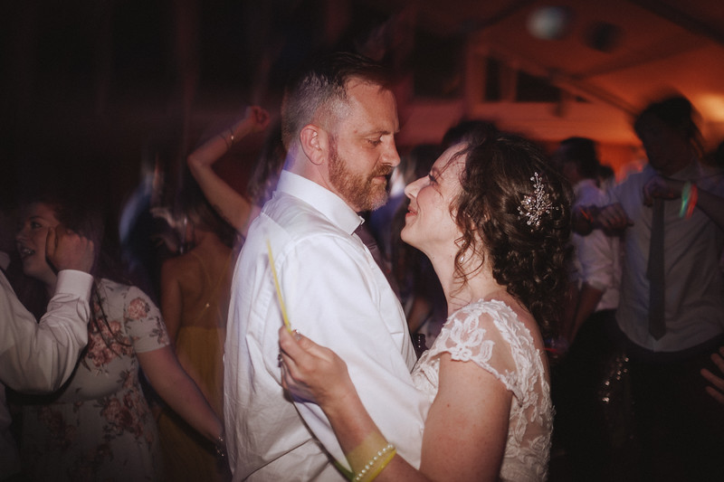The bride and groom dance, looking exhausted but in ecstasy.