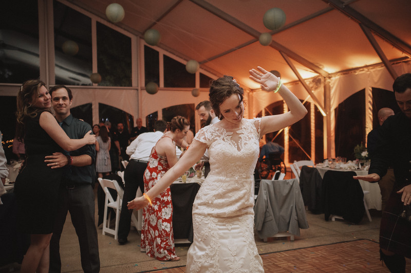 The bride dancing.