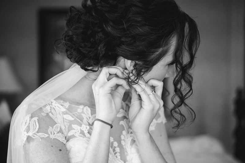 The bride putting in her earrings.