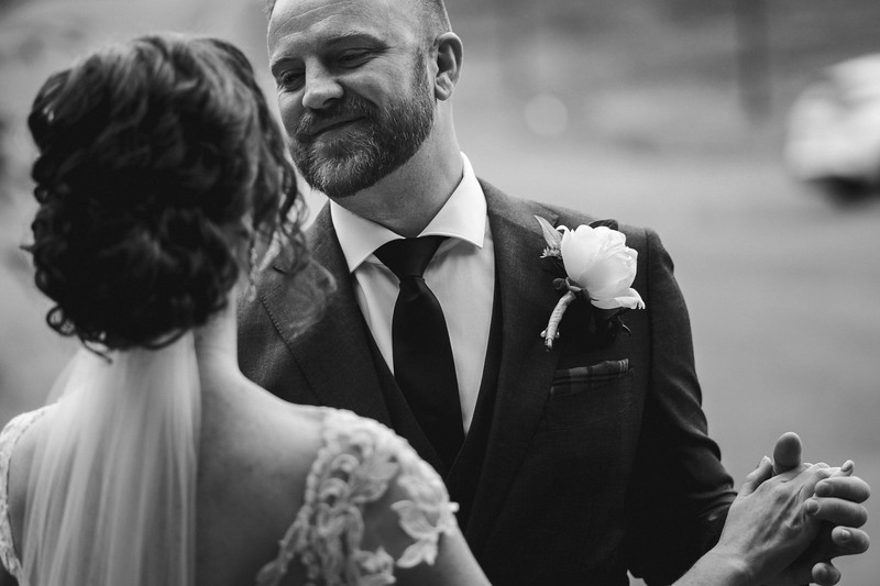 The groom with a warm and gentle smile as he sees the bride for the first time.