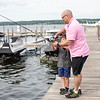 """Nick Perry fishes with his son Nathan 6, off of a boat dock Wednesday, June 12, 2019 near Sports Club. Perry has lived on the grounds for the past six years. """"I just love morning worship and sitting out by the Bell Tower it's just really peaceful."""" Perry said. MHARI SHAW/STAFF PHOTOGRAPHER"""
