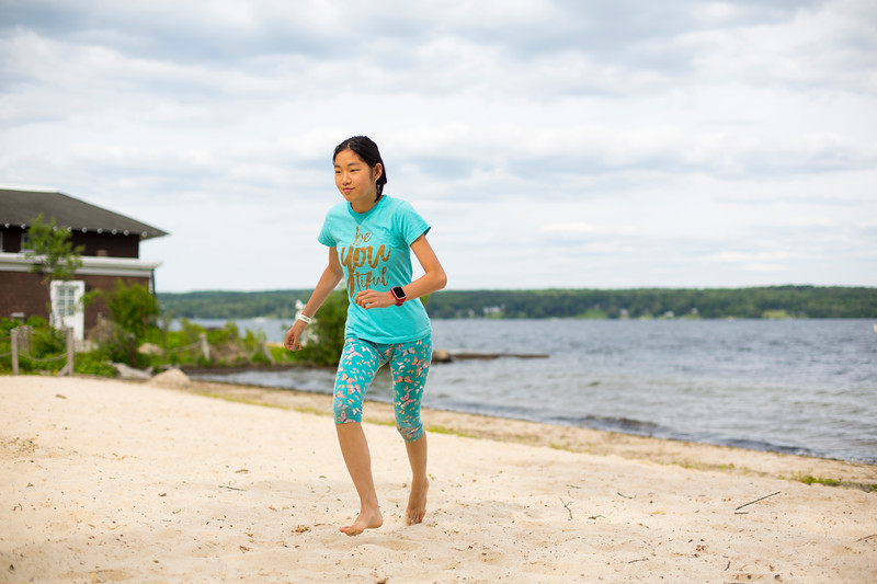 """Anna Chevrin, 14, runs in the sand Wednesday, June 12, 2019 on Children's Beach. """"It's a really nice place my family comes here almost every year."""" Chevrin said. MHARI SHAW/STAFF PHOTOGRAPHER"""
