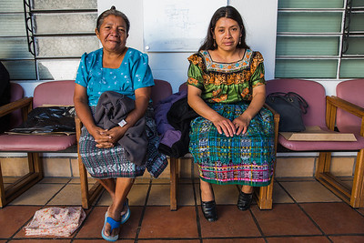 Two women wait to be screened on triage day. Photographed on assignment for Portland Magazine.