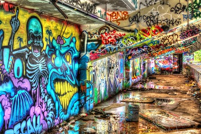 An abandoned stadium in Miami has become an art canvas for graffiti artists.  Often thought of an eyesore, I tried to capture this colorful graffiti art, coupled with the reflections in the water in a different light.